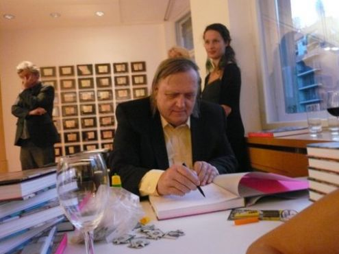 12-10-2010  Artist Jan Henderikse signing his book Jan Henderikse Acheiropoieta with  essays by Antoon Melissen and Renate Wiehager. In Berlin. Right is Rosa de Jong, Amsterdam. (photo Sherman de Jesus, Memphis Film + Television)