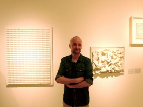 26-09-2014  Author Antoon Melissen at the  Manzoni show in the Peggy Guggenheim  Museum in Venice in front of work by Jan Schoonhoven.